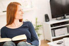 Woman Relaxing with a Book at Home Royalty Free Stock Image