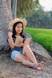 Woman relaxing with book Royalty Free Stock Photos