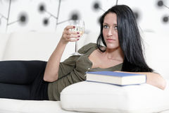 Woman relaxing with a book and wine Royalty Free Stock Photography