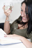Woman relaxing with a book and wine Royalty Free Stock Photos