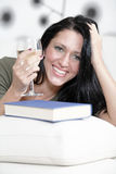 Woman relaxing with a book and wine Stock Photo