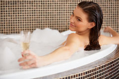 Woman Relaxing in Bubble Bath With Rose Petals. Body Care Royalty Free Stock Image