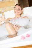 Woman Relaxing In Bubble Bath Stock Image