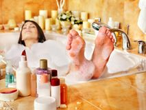 Woman relaxing at  bubble bath. Royalty Free Stock Images