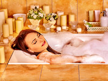 Woman relaxing at  bubble bath Royalty Free Stock Photos