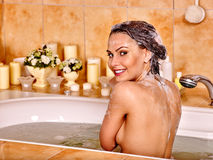 Woman relaxing at  bubble bath Royalty Free Stock Photography