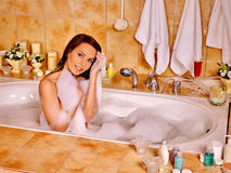Woman relaxing at  bubble bath Stock Image