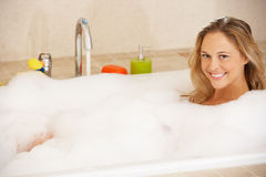 Woman Relaxing In Bubble Filled Bath Stock Photo