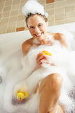 Woman Relaxing In Bubble Filled Bath Royalty Free Stock Photos