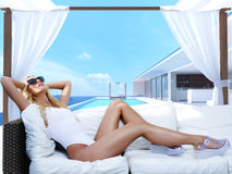 Woman relaxing in a cabana at the pool. 3d rendering. Woman relaxing in a cabana. 3d rendering royalty free stock photo