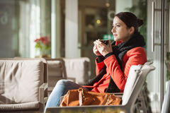 Woman relaxing at the cafe Royalty Free Stock Photos