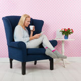 Woman relaxing in chair Stock Photo