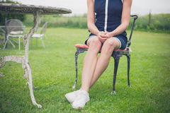 Woman relaxing on chair in a garden Royalty Free Stock Photos