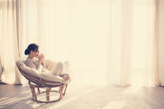 Woman relaxing in chair royalty free stock photo