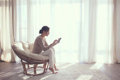 Woman relaxing in chair royalty free stock photos
