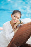 Woman relaxing in chaise-lounge Stock Photos