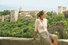Woman Relaxing On City Wall Royalty Free Stock Photo