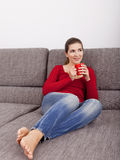 Woman relaxing with a coffee Royalty Free Stock Image