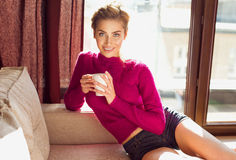 Woman relaxing with a coffee Stock Photography