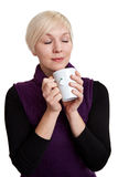 Woman relaxing with coffee and closed eyes Stock Photo