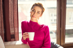 Woman relaxing with a coffee Royalty Free Stock Photos