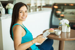 Woman relaxing in a coffee shop Stock Image