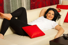 Woman relaxing on couch Royalty Free Stock Image