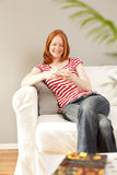 A woman relaxing on a couch Royalty Free Stock Image