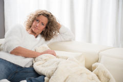 Woman relaxing on the couch Stock Photography