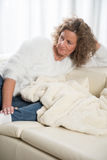 Woman relaxing on the couch Royalty Free Stock Image