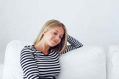 Woman relaxing on the couch. Portrait of a young woman relaxing on the couch Stock Photography