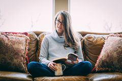 Woman relaxing on couch royalty free stock photography