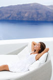 Woman Relaxing On Couch At Resort Terrace By Ocean Stock Photos