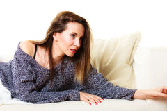 Woman relaxing on couch Stock Image
