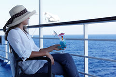 Woman relaxing during a cruise. On a summer day Royalty Free Stock Images