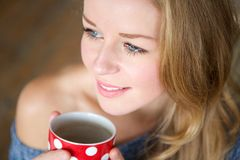 Woman relaxing with a cup of coffee Stock Photos
