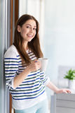 Woman relaxing with cup of coffee Stock Photography