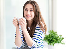 Woman relaxing with cup of coffee Stock Photos