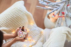 Woman relaxing with cup of hot chocolate and marshmallows Royalty Free Stock Photo