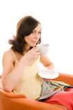 Woman relaxing with cup of tea Royalty Free Stock Photography
