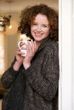 Woman relaxing with a cup of tea at home Royalty Free Stock Photography