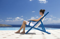 A woman relaxing in a deck chair Royalty Free Stock Image