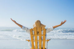 Woman relaxing in deck chair by the sea. On a sunny day Royalty Free Stock Images