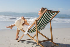 Woman relaxing in deck chair by the sea Royalty Free Stock Photo