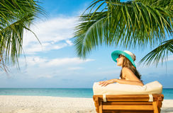 Woman relaxing on deckchair Royalty Free Stock Photo