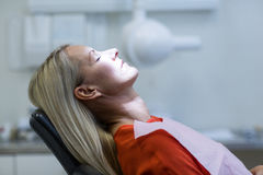 Woman relaxing on dentist chair Stock Photos