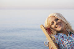 Woman Relaxing On Desk Chair At Beach Stock Photography