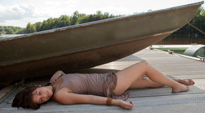 Woman Relaxing on Dock Stock Photo