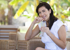 A woman relaxing with a drink Stock Photos