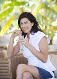 A woman relaxing with a drink Stock Photography